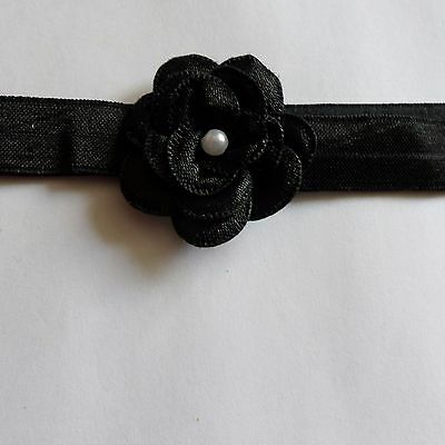 baby headband 0-3 months black with a black flower