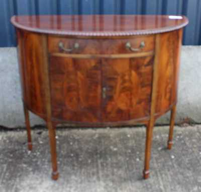 .1920's Mahogany Half Moon Cabinet with cupboard and Drawer.