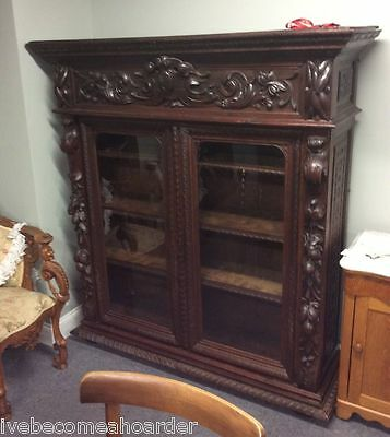 Heavily Carved Antique European Oak Double Door Bookcase