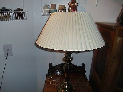 brass table lamp two lights very heavy with very nice beige colored shade