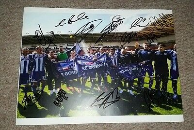 Wigan Athletic 20162017 squad signed promotion 16x12 photo AFTAL PROOF