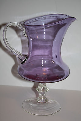 Amethyst  glass pitcher with applied handle and pedestal base