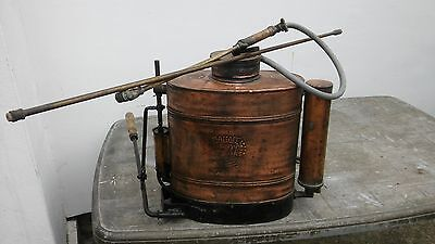 Vintage Copper Brass tank backpack sprayer for grapes in the vineyard