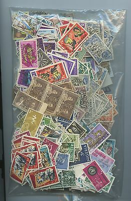 NIGRIA--Accumulation of Approx. 3,700 stamps 7.4 ounces