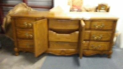 triple dresser oak circa 1970 with 2 matching night stands