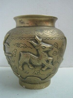Antique Chinese or Japonese bronze Vase Carved with animals signed in the bottom