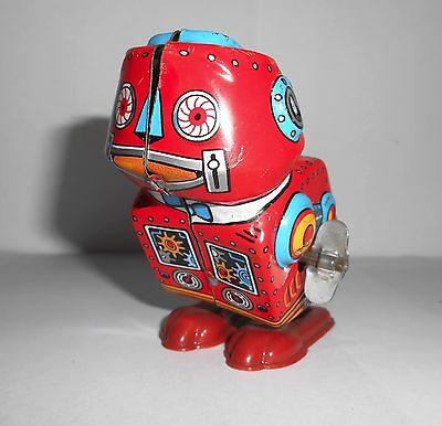 1960`s Yone Japan tinplate jumping robot toy 2097 in red vintage collectable