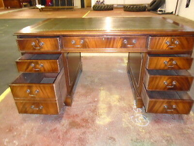 Mahogany Kneehole desk with green leather top