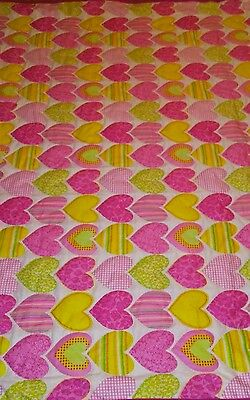 Handmade baby girl quilt with hearts