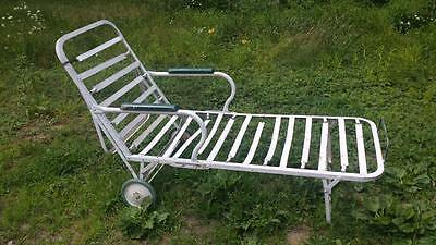 Antique metal garden chaise lounge beach cabana w green wheels and wood armrests