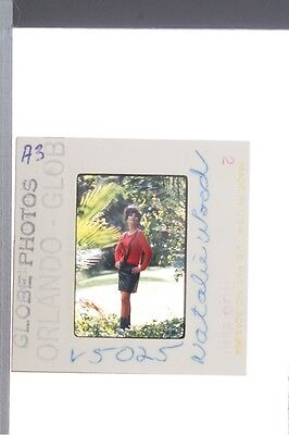Slide of American television actress Natalie Wood being photographed posing at g