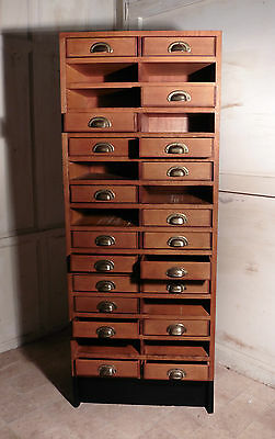 A Tall Art Deco Oak Filing Cabinet, Haberdashers Shelves