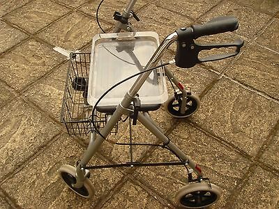 4 wheeled walking aid with seat brakes and basket
