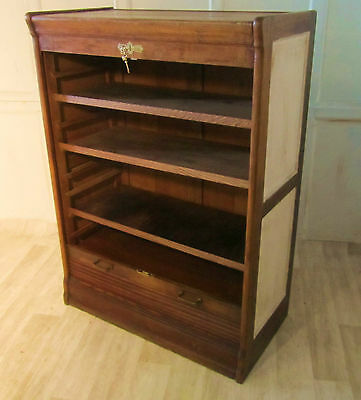 A Large Tambour Fronted Oak Art Deco Filing Cabinet