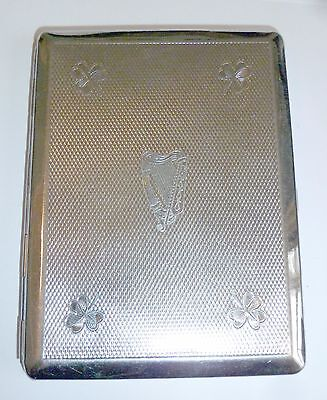 An Art Deco Chrome Plated Cigarette Case With Engraved Harp & Shamrocks