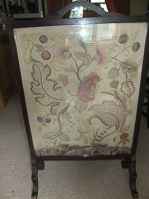 Mahogany framed fire screen with long stitched embroidered floral panel