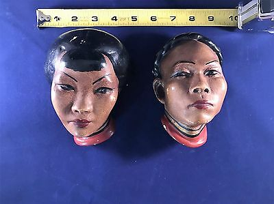 Vintage Asian Chalkware heads wall hangings