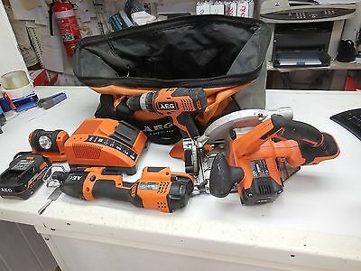 AEG 18v combo -hammer drill 2 saws torch  battery charger bag exc condition