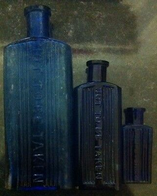Three Not To Be Taken Blue Poison Bottles