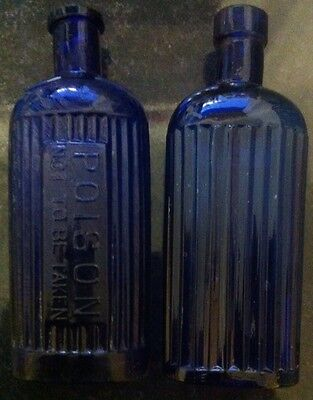 Two Blue Poison Bottles