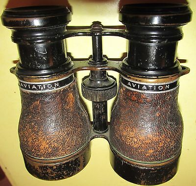 Stylish Early 1900s brass with leather over  hood embossed 'Aviation' binoculars