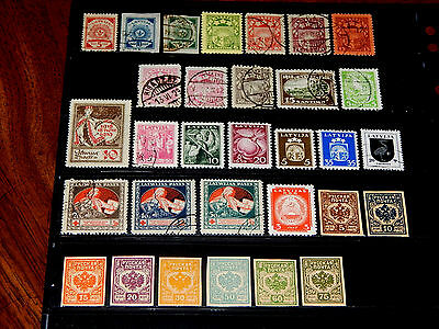 Latvia stamps for sale - 31 mint hinged and used early stamps - super !!