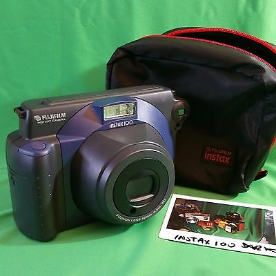 Fujifilm INSTAX 100 instant camera with soft carry case.  Tested, working