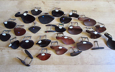Large Selection of vintage and antique violin chin rests.