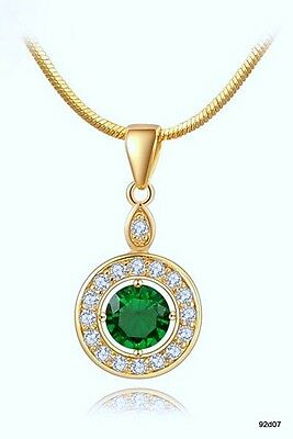 """ OR GOLDFILLED 18 CARATS  zircon vert  + des petits blancs"