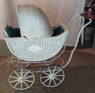 antique baby carriage/buggy, wooden wheels, wicker
