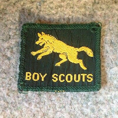 Vintage Boy Scout badge fully bound leaping wolf badge