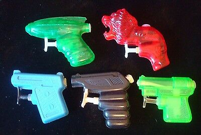 SELECTION OF 1960s PLASTIC WATER PISTOLS SPACE -  WEE GEE -  LION 5 IN TOTAL