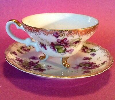 Footed Tea Cup And Saucer With Gilded Feet Handle And Rims - Lovely Violets