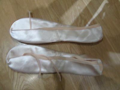 Pair of girls' pink ballet shoes size 5