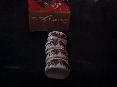 Poinsettia and ribbons napkin rings porcelain Holiday Set Of 4 New in box