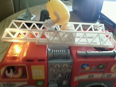 M&M Christmas candy dispenser Firetruck. Tested works great!