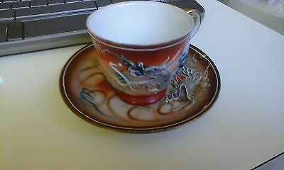 sml multi coloured Antique Asian Japanese??dragon cup&saucer bit of crazing