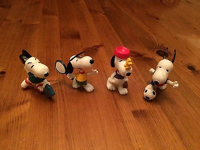 Four Peanuts Snoopy Characters
