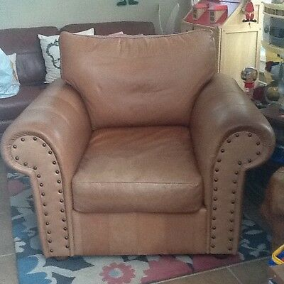 Used brown leather armchair