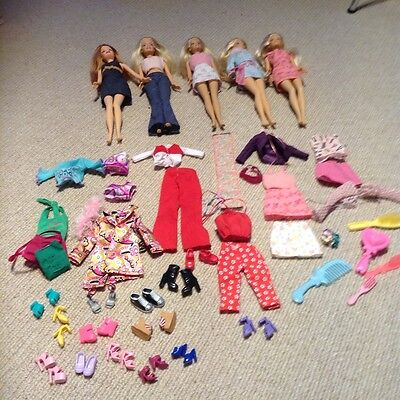 Bundle of 5 Barbie dolls with clothes and accessories excellent condition