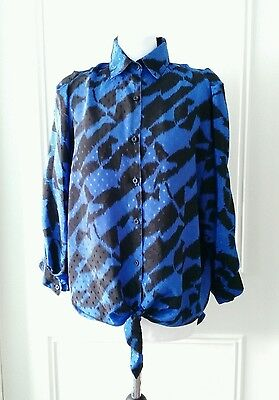 Oversized 1980's vintage patterned blouse with batwing arms size 12