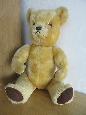 Golden growling jointed teddy by Deans.