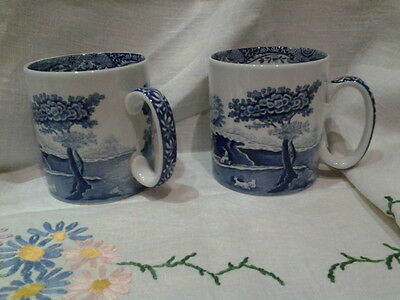 A pair of two italian Spode blue mugs