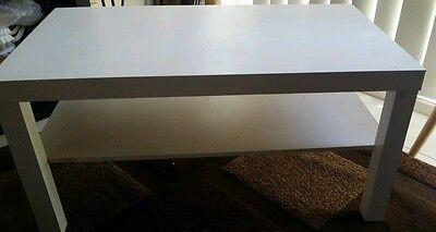 White coffee table with matching lamp/side table