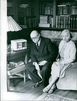 Vintage photo of Jean Rostand sitting quietly with a woman, 1959