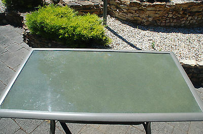 Small Outdoor Glass Table