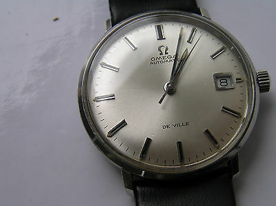 omega s/s deville.silver starburst effect dial. cal 565 watch