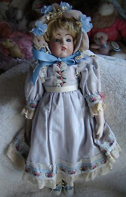 "Lilian Middleton Repro porcelain doll in beautiful clothing. Approx 21"" tall"