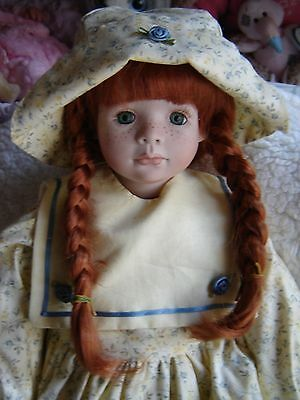 """Lovely artist made porcelain doll. Approx 21"""" tall if standing. Sitting Doll."""