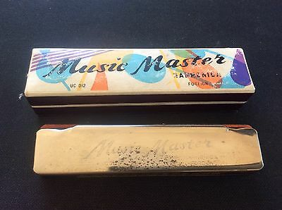 Vintage boxed music master Harmonica Foreign in Box UC 012 Mouth Organ some wear